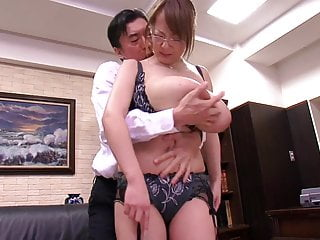 Asian with big tits undressing at the office